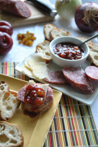 Plates of cheese and bread with Asian Plum Onion Chutney