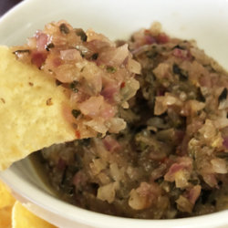 Charred Onion Salsa on a tortilla chip